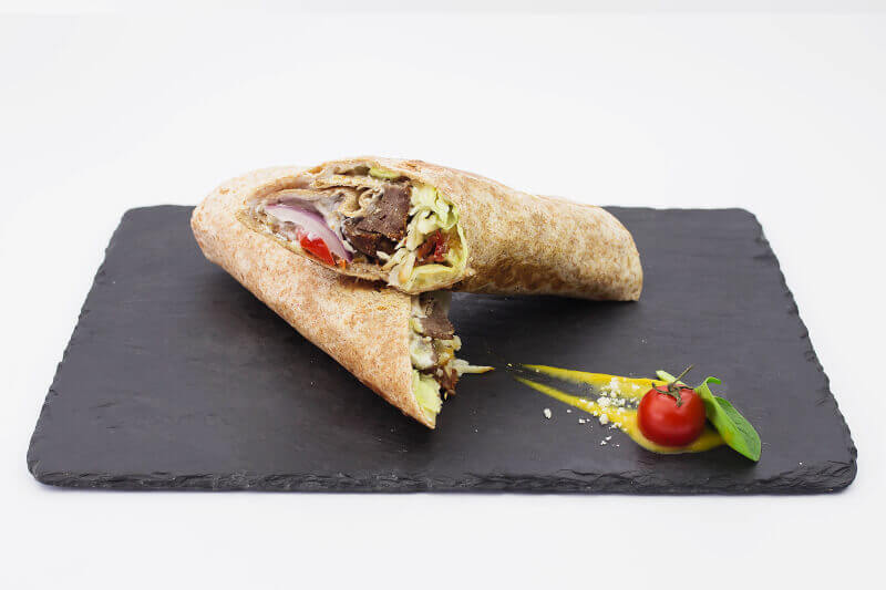 Tortilla wrapped beef burger with smoked cheese